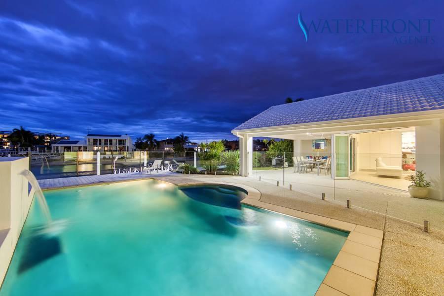 25 Myoora Court, Minyama pool area lit up