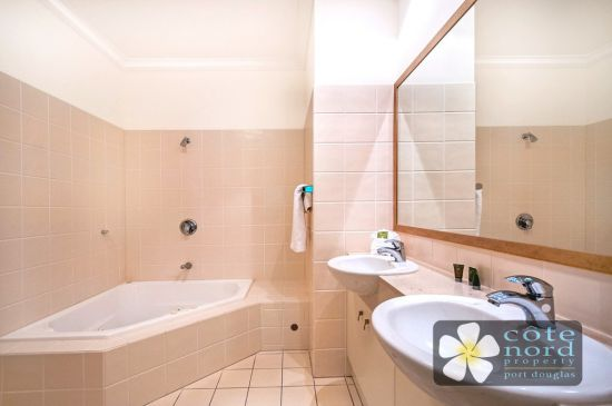 Ensuite with jacuzzi spa bath and twin handbasins