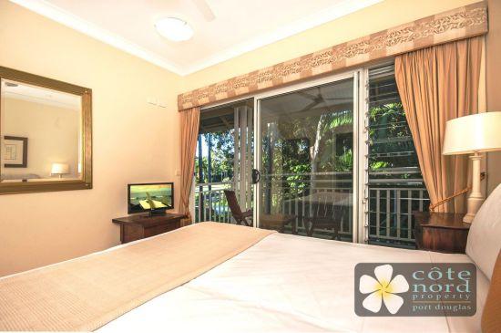 Main bedroom with rainforest garden views