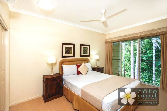 Spacious second bedroom with rainforest garden vie