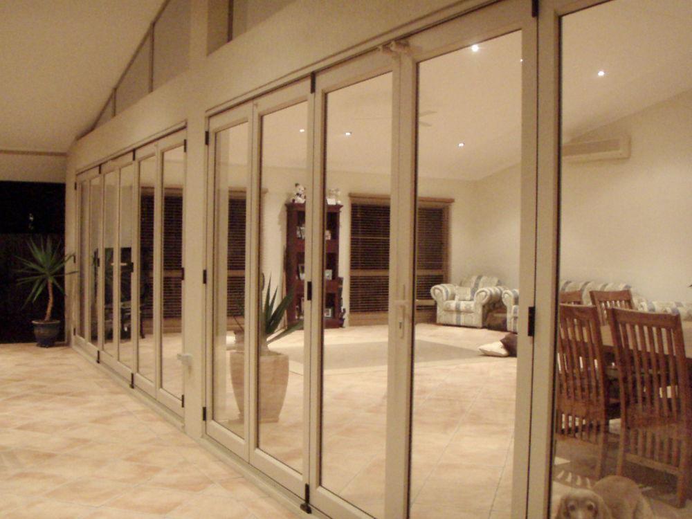 Bifold doors separating indoor and outdoor area
